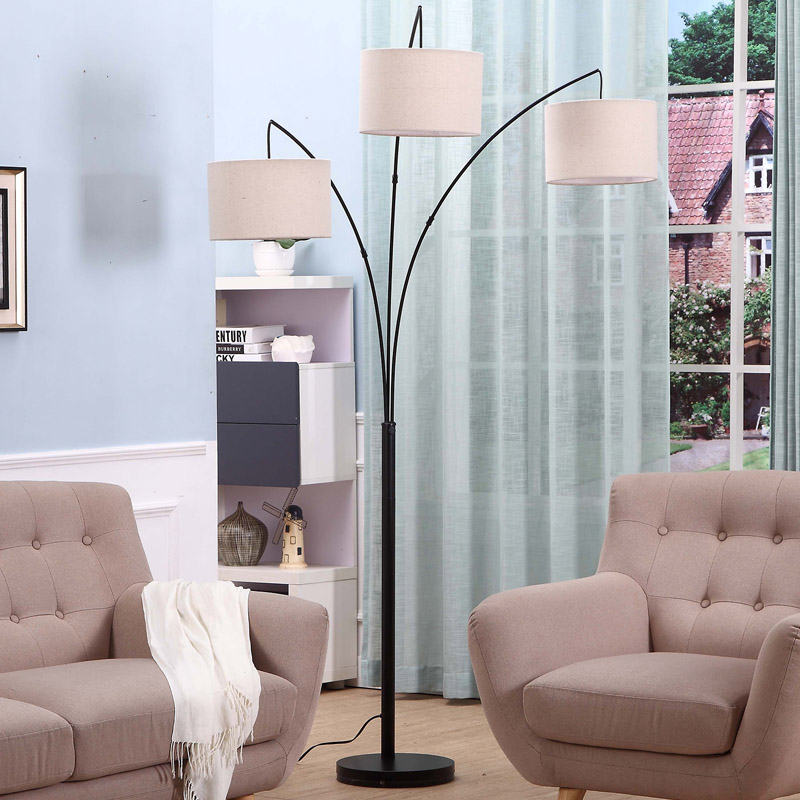https://www.goodly-light.com/black-tall-multiple-head-arc-lamp-with-3-fabric-shade-hanging-lighting-for-reading-offices-modern-3-arm-floor-light-for-standing-behind-the-living-room-sofa-gl-flm03.html